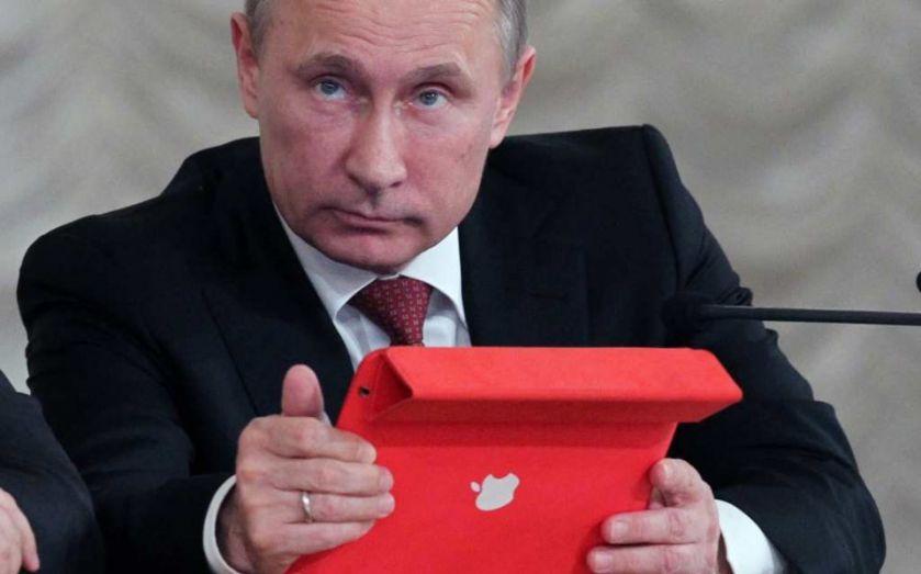 putin with ipad getty 57ed7c28915c2 57ed7c28affda - Apple reçoit un grand coup de pression par la Russie